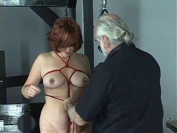 Red head sub gets her arms and tits bounded