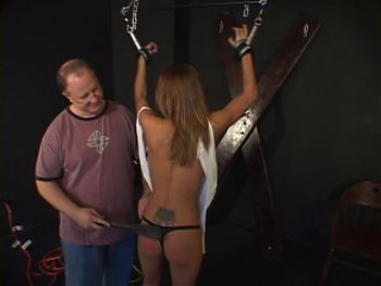 Small tits slave gets her ass spanked with a paddle